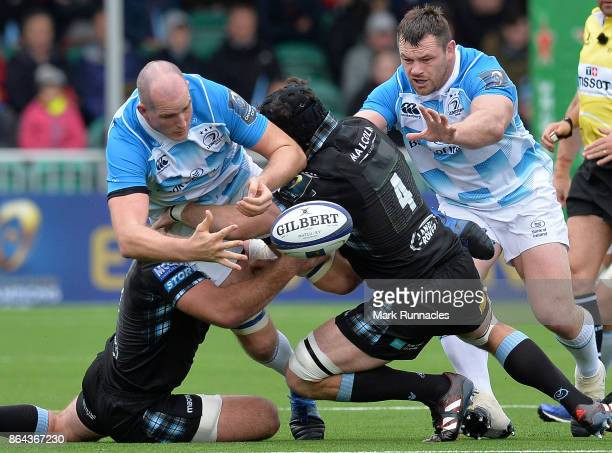 Devon Toner of Leinster Rugby is tackled by Tim Swinson of Glasgow Warriors during the European Rugby Champions Cup match between Glasgow Warriors...