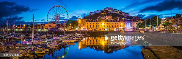 Devon Torquay harbour marina illuminated at sunset panorama Torbay UK