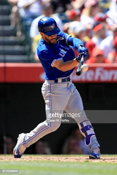 Devon Travis of the Toronto Blue Jays after hits a tworun homerun during the eighth inning of a game against the Los Angeles Angels of Anaheim at...