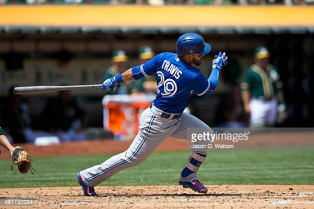 Devon Travis of the Toronto Blue Jays at bat against the Oakland Athletics during the second inning at Oco Coliseum on July 23 2015 in Oakland...