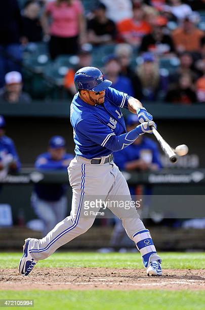 Devon Travis of the Toronto Blue Jays bats against the Baltimore Orioles at Oriole Park at Camden Yards on April 12 2015 in Baltimore Maryland