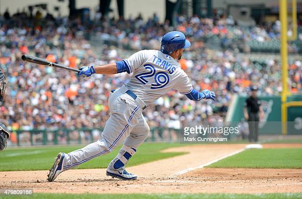 Devon Travis of the Toronto Blue Jays bats during the game against the Detroit Tigers at Comerica Park on July 4 2015 in Detroit Michigan The Tigers...