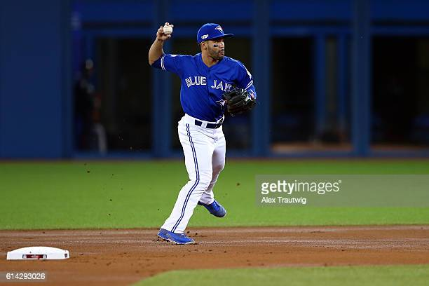 Devon Travis of the Toronto Blue Jays fields the ball during the American League Wild Card Game against the Baltimore Orioles at the Rogers Centre on...