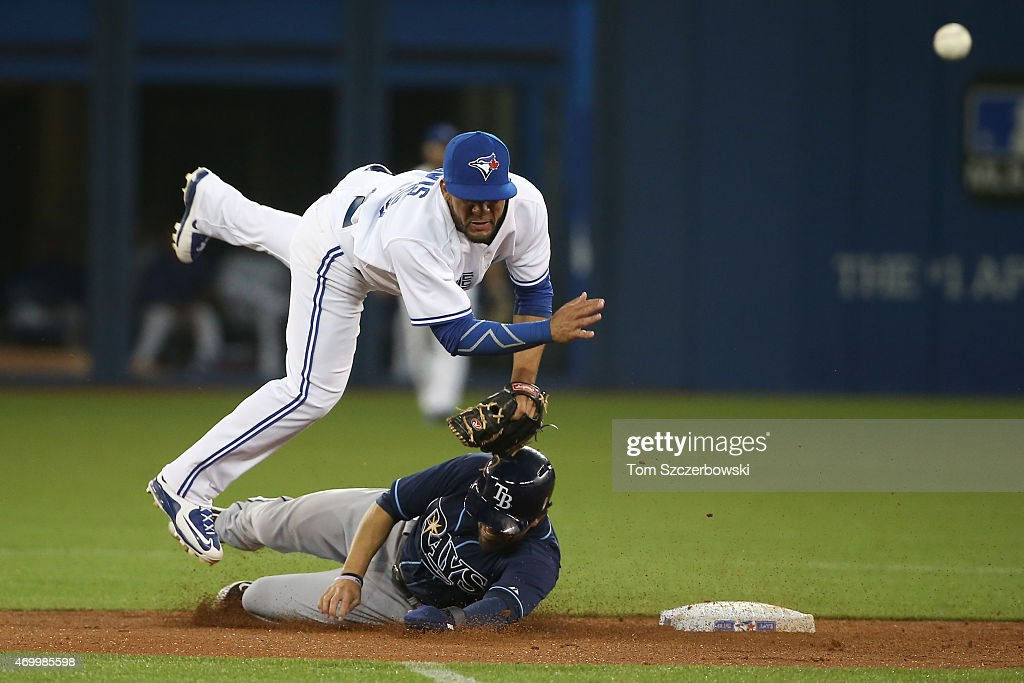 <a gi-track='captionPersonalityLinkClicked' href=/galleries/search?phrase=Devon+Travis&family=editorial&specificpeople=3174405 ng-click='$event.stopPropagation()'>Devon Travis</a> #29 of the Toronto Blue Jays gets the force out at second base but did not turn the double play in the third inning during MLB game action as <a gi-track='captionPersonalityLinkClicked' href=/galleries/search?phrase=David+DeJesus&family=editorial&specificpeople=206765 ng-click='$event.stopPropagation()'>David DeJesus</a> #7 of the Tampa Bay Rays slides on April 16, 2015 at Rogers Centre in Toronto, Ontario, Canada.