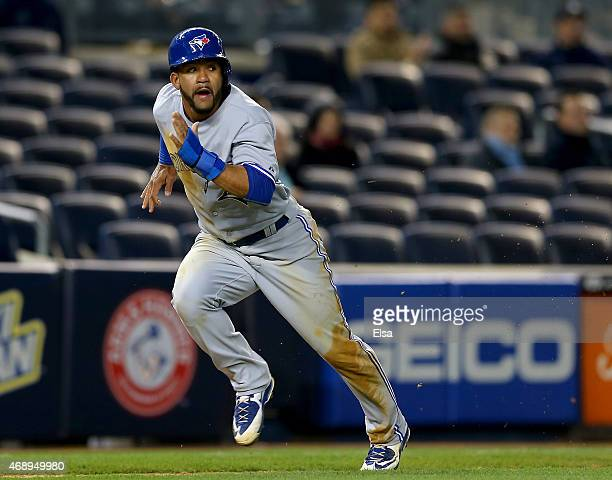 Devon Travis of the Toronto Blue Jays heads for home on a SAC fly by teammate Russell Martin in the fifth inning against the New York Yankees on...