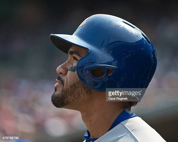 Devon Travis of the Toronto Blue Jays heads out of the dugout to the ondeck circle during a MLB game against the Detroit Tigers at Comerica Park on...