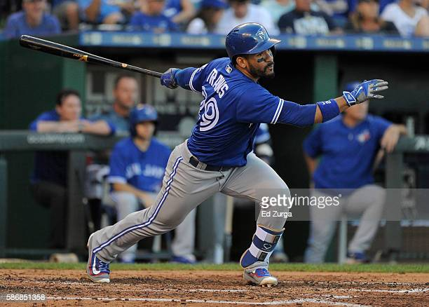 Devon Travis of the Toronto Blue Jays hits a RBI single in the fifth inning against the Kansas City Royals at Kauffman Stadium on August 6 2016 in...