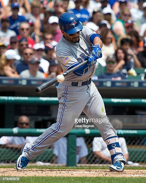 Devon Travis of the Toronto Blue Jays hits the ball during a MLB game against the Detroit Tigers at Comerica Park on July 4 2015 in Detroit Michigan