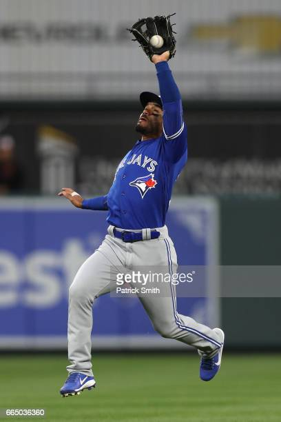 Devon Travis of the Toronto Blue Jays makes a catch on a hit by Adam Jones of the Baltimore Orioles during the first inning at Oriole Park at Camden...