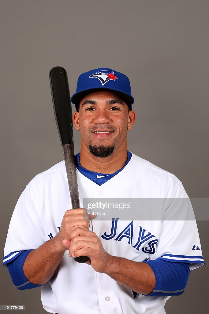 Devon Travis #77 of the Toronto Blue Jays poses during photo day on February 28, 2015 in Dunedin, Florida.