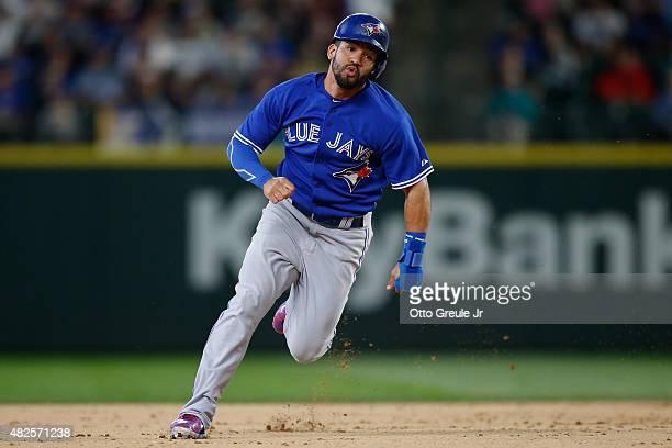 Devon Travis of the Toronto Blue Jays rounds the bases against the Seattle Mariners at Safeco Field on July 26 2015 in Seattle Washington