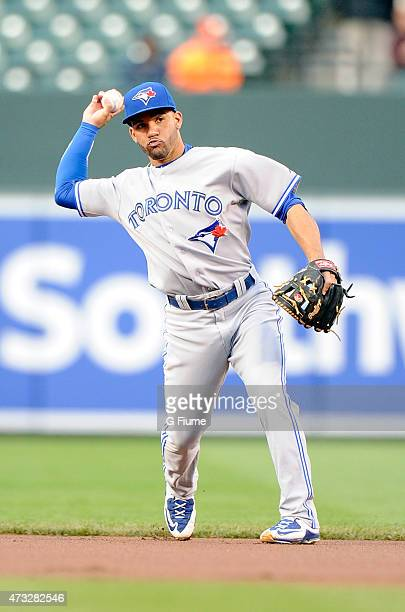 Devon Travis of the Toronto Blue Jays throws the ball to first base against the Baltimore Orioles at Oriole Park at Camden Yards on May 13 2015 in...
