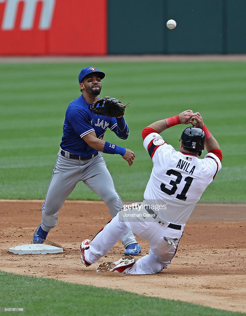 <a gi-track='captionPersonalityLinkClicked' href=/galleries/search?phrase=Devon+Travis&family=editorial&specificpeople=3174405 ng-click='$event.stopPropagation()'>Devon Travis</a> #29 of the Toronto Blue Jays turns a double play over <a gi-track='captionPersonalityLinkClicked' href=/galleries/search?phrase=Alex+Avila&family=editorial&specificpeople=5749211 ng-click='$event.stopPropagation()'>Alex Avila</a> #31 of the Chicago White Sox in the 2nd inning at U.S. Cellular Field on June 26, 2016 in Chicago, Illinois.