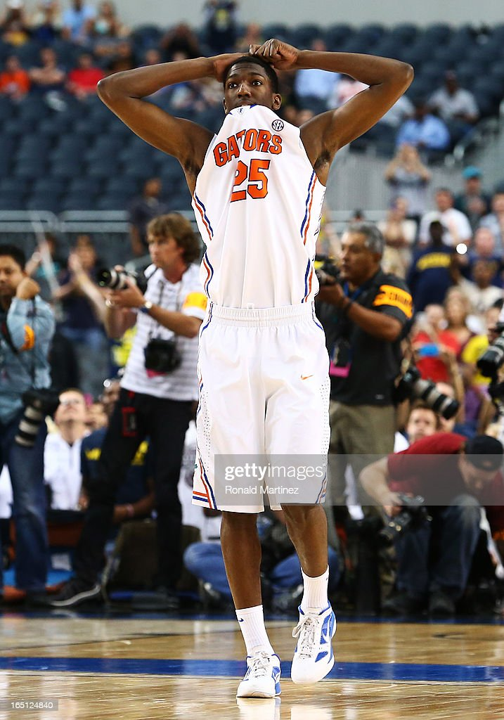 DeVon Walker #25 of the Florida Gators reacts to their 79 to 59 loss to the Michigan Wolverines during the South Regional Round Final of the 2013 NCAA Men's Basketball Tournament at Dallas Cowboys Stadium on March 31, 2013 in Arlington, Texas.