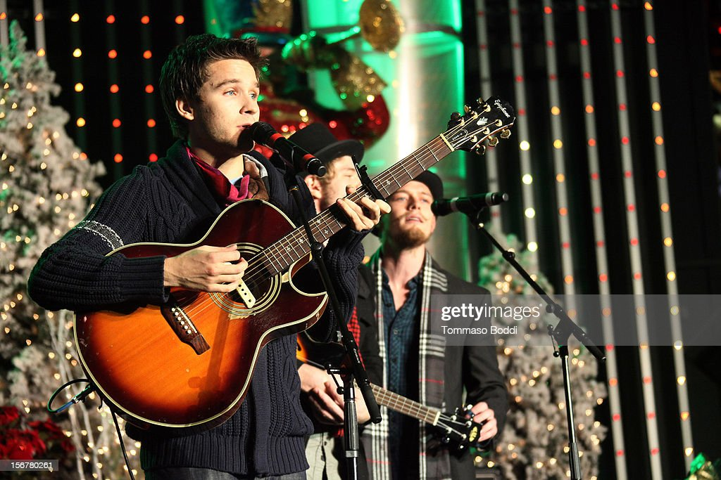 <a gi-track='captionPersonalityLinkClicked' href=/galleries/search?phrase=Devon+Werkheiser&family=editorial&specificpeople=583997 ng-click='$event.stopPropagation()'>Devon Werkheiser</a> performs at the 2012 Hollywood Christmas Parade Concert held at Universal CityWalk on November 20, 2012 in Universal City, California.