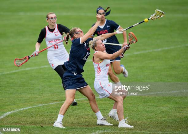 Devon Wills of the United States and Malgorzata Kacperczyk of Poland compete for the ball during the Lacrosse Women's match between USA and Poland of...