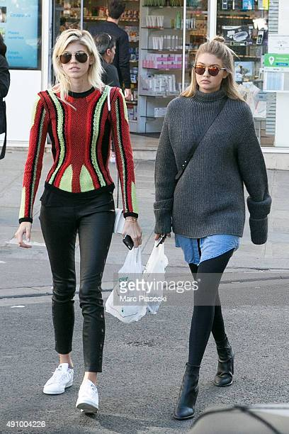 Devon Windsor and Gigi Hadid leave 'Saint Germain des Pres' Pharmacy on October 2 2015 in Paris France