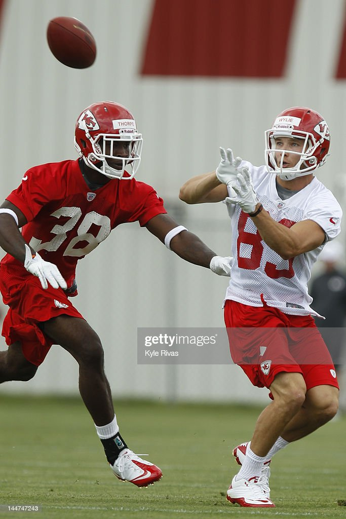 Devon Wylie #83 catches a pass while avoiding the outstretched hand of Neiko Thorpe #38 of the Kansas City Chiefs during the Kansas City Chiefs minicamp on May 13, 2012 at the Chiefs Training Facility in Kansas City, Missouri.