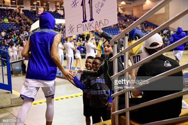 Devonne Pinkard of the Delaware Fightin Blue Hens highfives kids holding a sign to honor him before taking on the William Mary Tribe at the Bob...