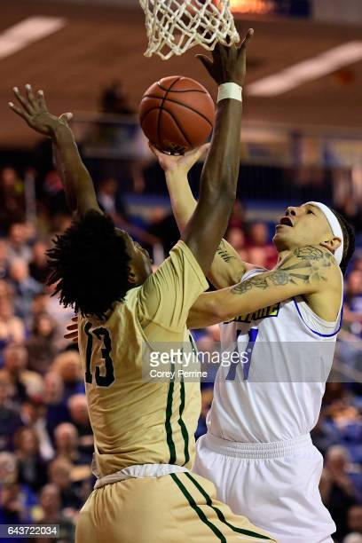 Devonne Pinkard of the Delaware Fightin Blue Hens shoots the ball against Nathan Knight of the William Mary Tribe during the first half at the Bob...