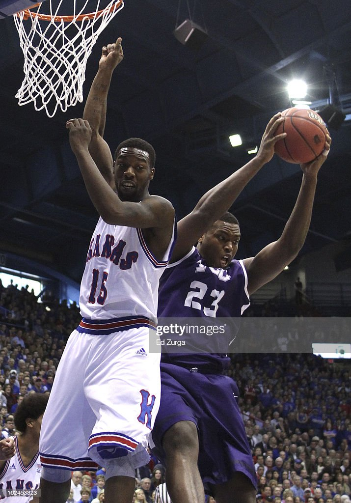 Devonta Abron #23 of the TCU Horned Frogs grabs a rebound past Elijah Johnson #15 of the Kansas Jayhawks at Allen Field House on February 23, 2013 in Lawrence, Kansas.