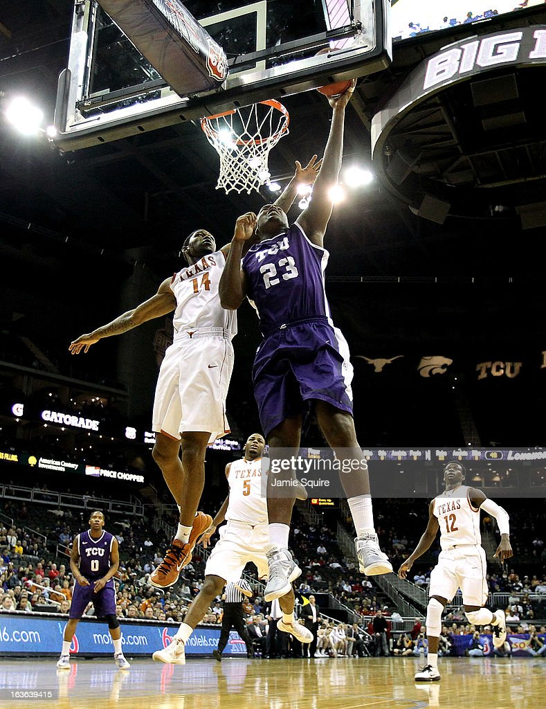 Devonta Abron #23 of the TCU Horned Frogs shoots on a fast break as Julien Lewis #14 of the Texas Longhorns defends during the first round of the 2013 Big 12 Men's Basketball Championship at Sprint Center on March 13, 2013 in Kansas City, Missouri.