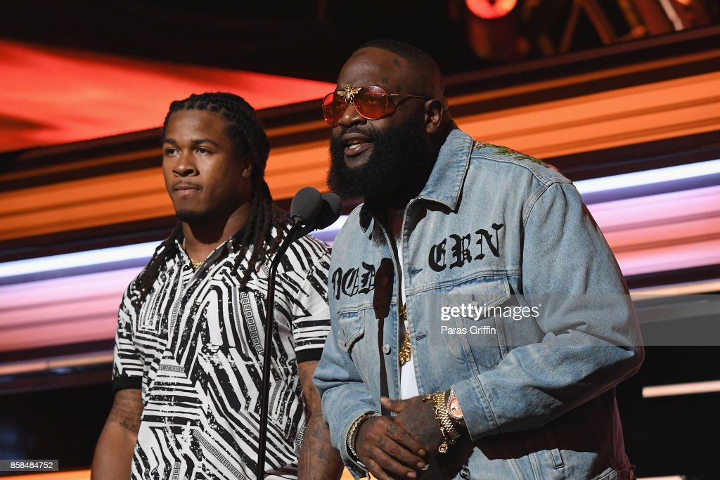 Devonta Freeman and Rick Ross onstage during the BET Hip Hop Awards 2017 at The Fillmore Miami Beach at the Jackie Gleason Theater on October 6, 2017 in Miami Beach, Florida.