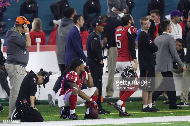 Devonta Freeman of the Atlanta Falcons and Matt Bosher react after losing to the New England Patriots 3428 during Super Bowl 51 at NRG Stadium on...