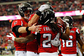Devonta Freeman of the Atlanta Falcons celebrates a touchdown with Matt Ryan during the first half against the New Orleans Saints at the Georgia Dome...
