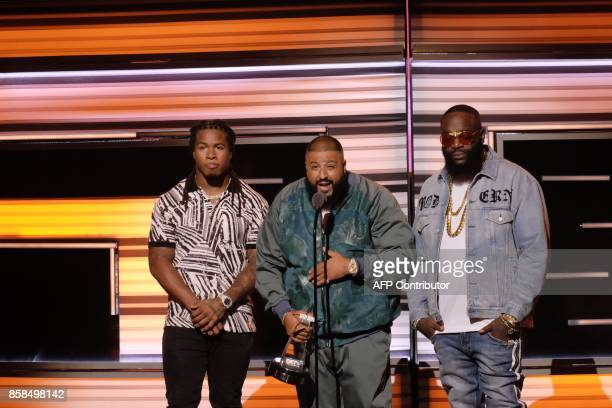Devonta Freeman of the Atlanta Falcons Dj Khaled and Rick Ross present Uncle Luke with the 'I Am Hip Hop' award during the BET Hip Hop Awards 2017 at...