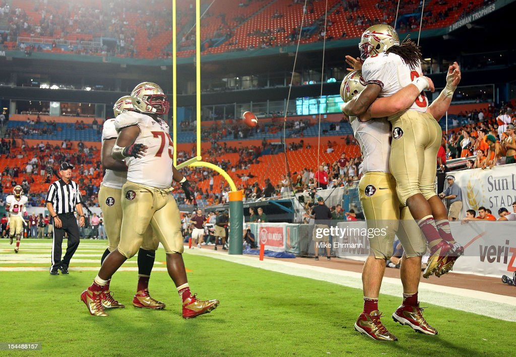 Devonta Freeman #8 of the Florida State Seminoles celebrates a touchdown during a game against the Miami Hurricanes at Sun Life Stadium on October 20, 2012 in Miami Gardens, Florida.