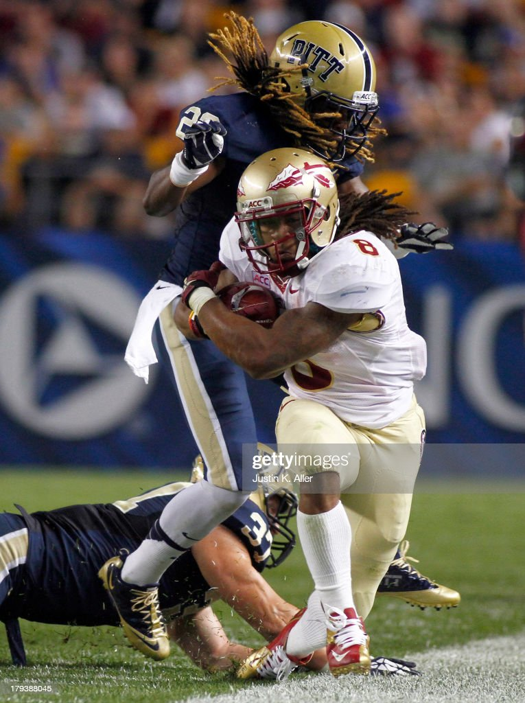 Devonta Freeman #8 of the Florida State Seminoles rushes in the first half against Tyler Boyd #23 of the Pittsburgh Panthers during the game on September 2, 2013 at Heinz Field in Pittsburgh, Pennsylvania.
