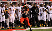 Devontae Booker of the Utah Utes runs for a 62 yard touchdown in the fourth quarter of their 3418 win over the Arizona State Sun Devils in their game...