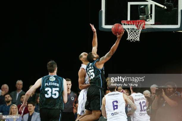 Devonte DJ Newbill of the Breakers goes up against Perry Ellis of the Kings during the round three NBL match between the New Zealand Breakers and the...