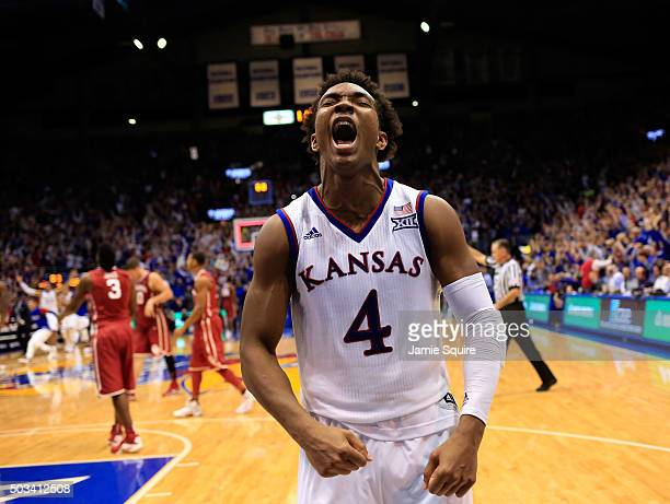Devonte' Graham of the Kansas Jayhawks celebrates as the Jayhawks defeat the Oklahoma Sooners 109106 in triple overtime to win the game at Allen...