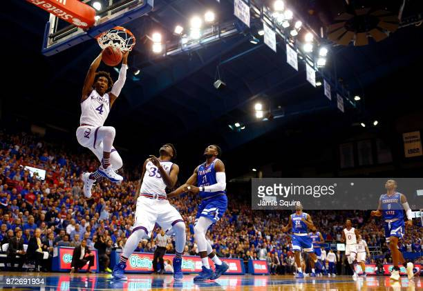 Devonte' Graham of the Kansas Jayhawks dunks on a fast break during the game against the Tennessee State Tigers at Allen Fieldhouse on November 10...