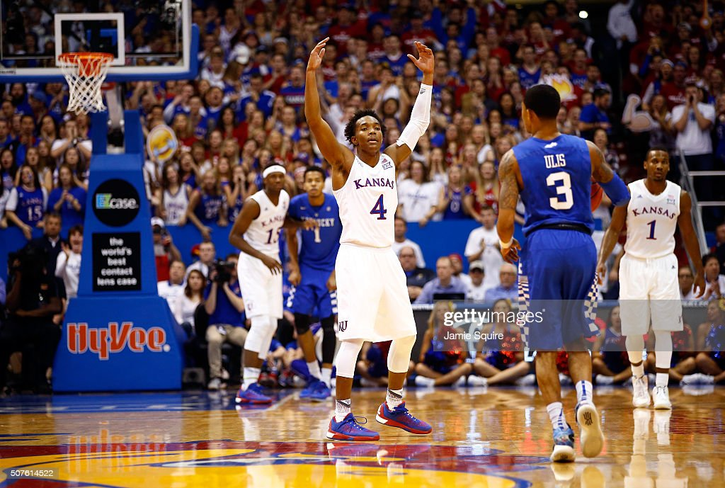 Devonte' Graham of the Kansas Jayhawks energizes the crowd during the 1st half of the game against the Kentucky Wildcats at Allen Fieldhouse on...
