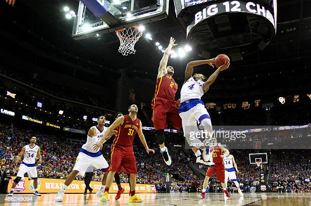 Devonte Graham of the Kansas Jayhawks goes up against Abdel Nader of the Iowa State Cyclones in the first half during the championship game of the...