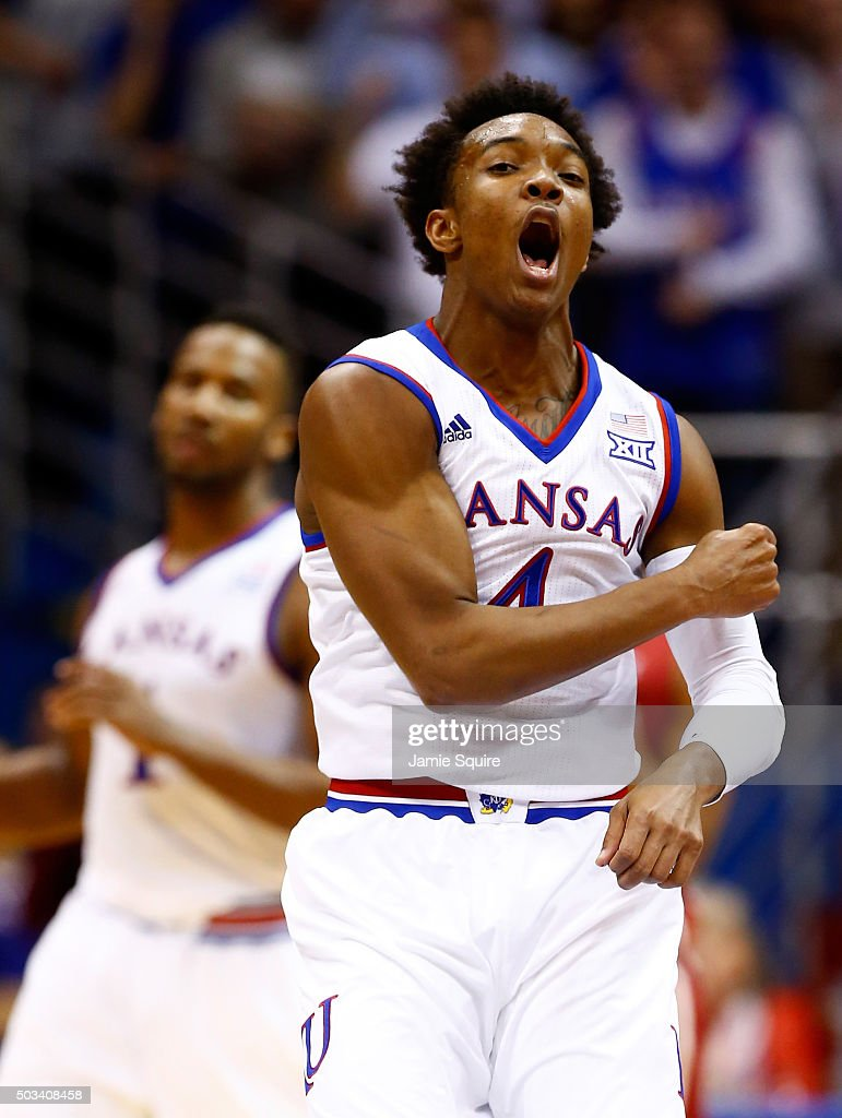 Devonte' Graham of the Kansas Jayhawks reacts after making a basket during the game against the Oklahoma Sooners at Allen Fieldhouse on January 4...