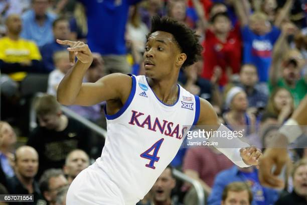 Devonte' Graham of the Kansas Jayhawks reacts after making a three point basket in the first half against the Purdue Boilermakers during the 2017...