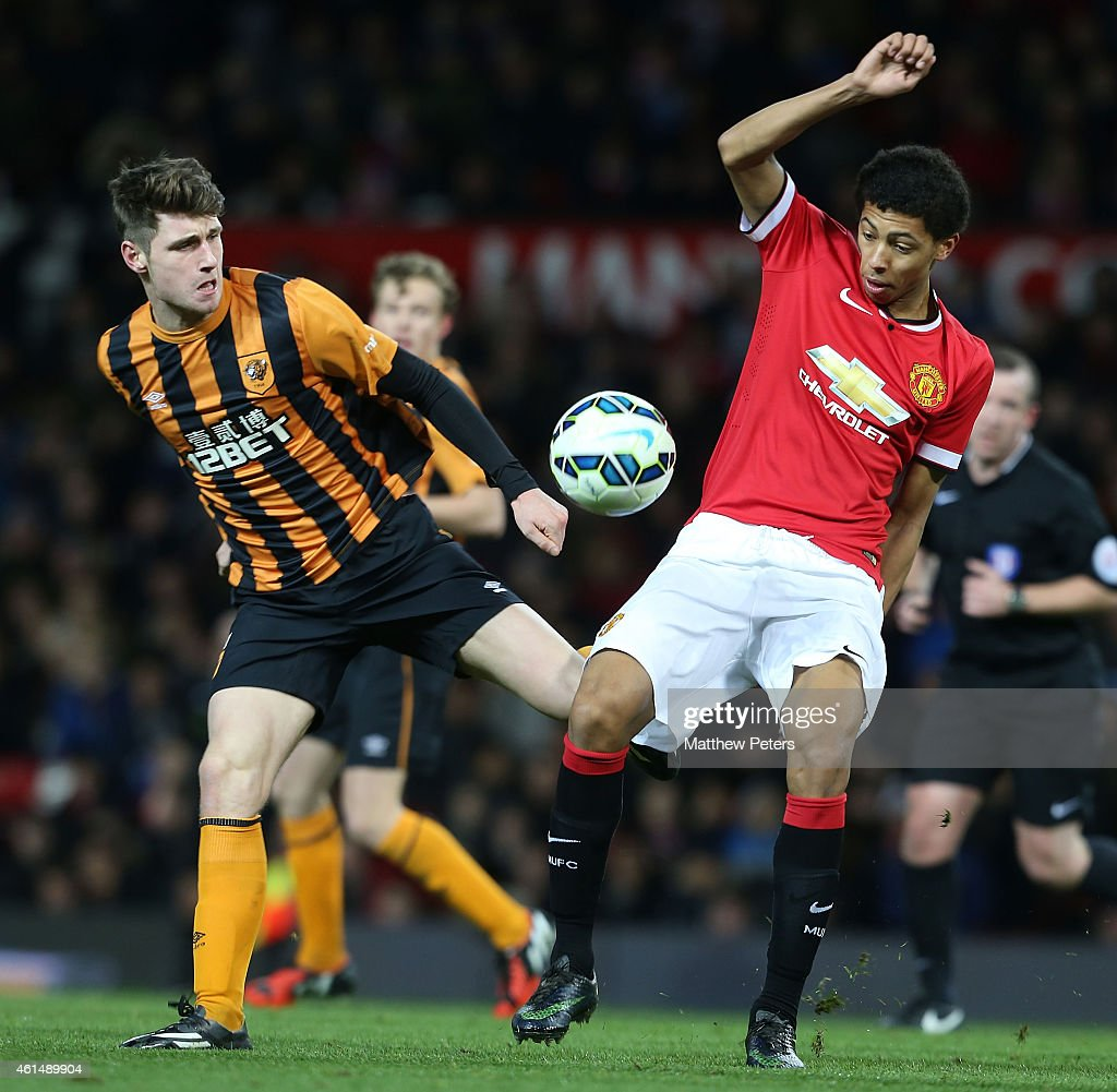 Devonte Redmond of Manchester United U18s in action with William Annan of Hull City U18s during the FA Youth Cup Fourth Round match between Manchester United U18s and Hull City U18s at Old Trafford on January 13, 2015 in Manchester, England.