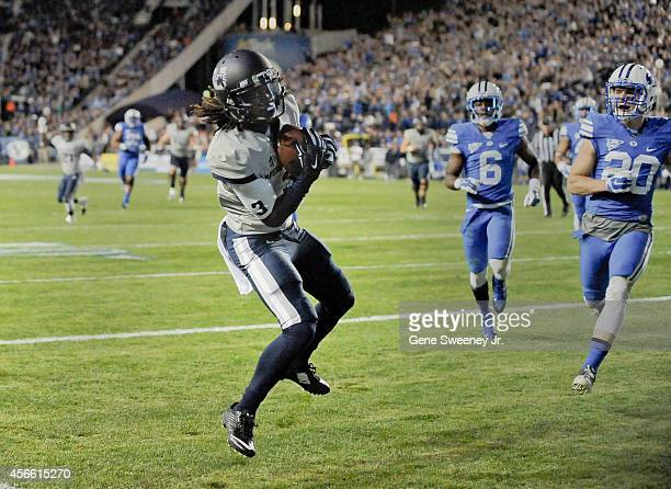 Devonte Robinson of the Utah State Aggies catches a secondquarter touchdown pass during a game against Brigham Young Cougars at LaVell Edwards...