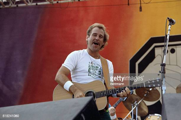 Musician Jimmy Buffett performs at the 1982 US Festival Slide shows waist up of Jimmy Buffett singing and playing guitar The US Festival was...
