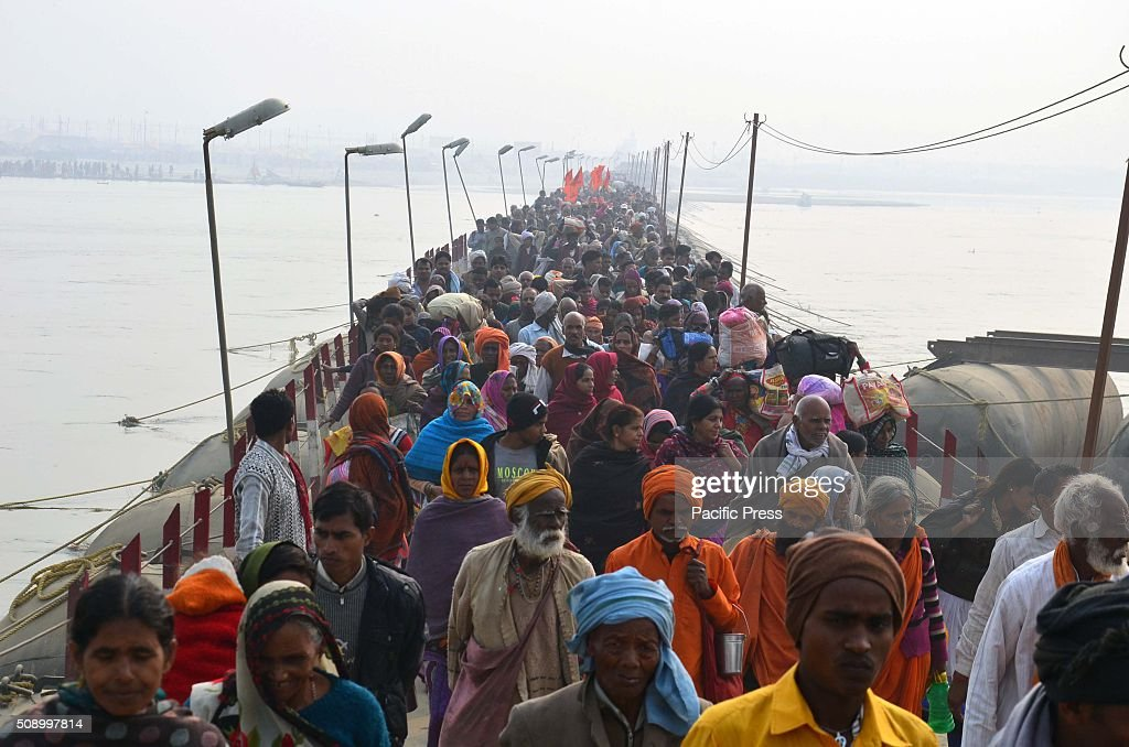 Devotee arrival to take holydip at Sangam, the confluence of River Ganga Yamuna and mythological Saraswati on the occasion of Maghi Purnima the main holy bathing day during Magh mela festival.
