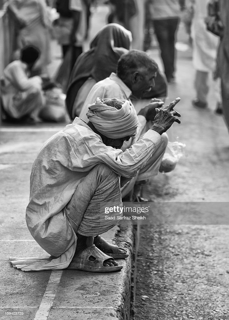 CONTENT] A devotee at Data Darbar's shrine in Lahore.