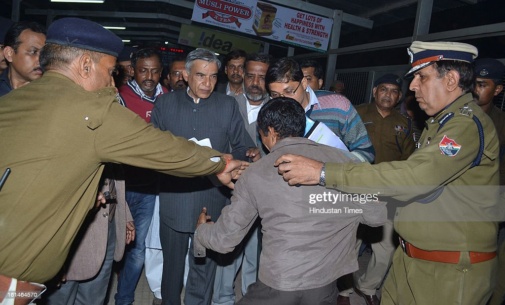 A devotee breaks down in front of Railway Minister Pawan Kumar Bansal during his inspection of Allahabad Railway station, the site of last night's stampede, during the Maha Kumbh Mela on February 11, 2013 in Allahabad, India. According to a government sources report, at least 36 people died in a stampede on a stair case as a train was pulling up on the busiest day of the Maha Kumbh Mela.