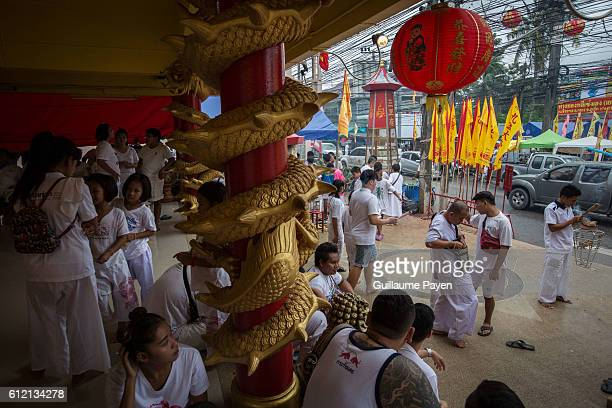 Devotee from the Chinese Sam Ong Hoo Shrine waits a ceremony ahead of a street procession during the yearly Vegetarian Festival also knows as Nine...