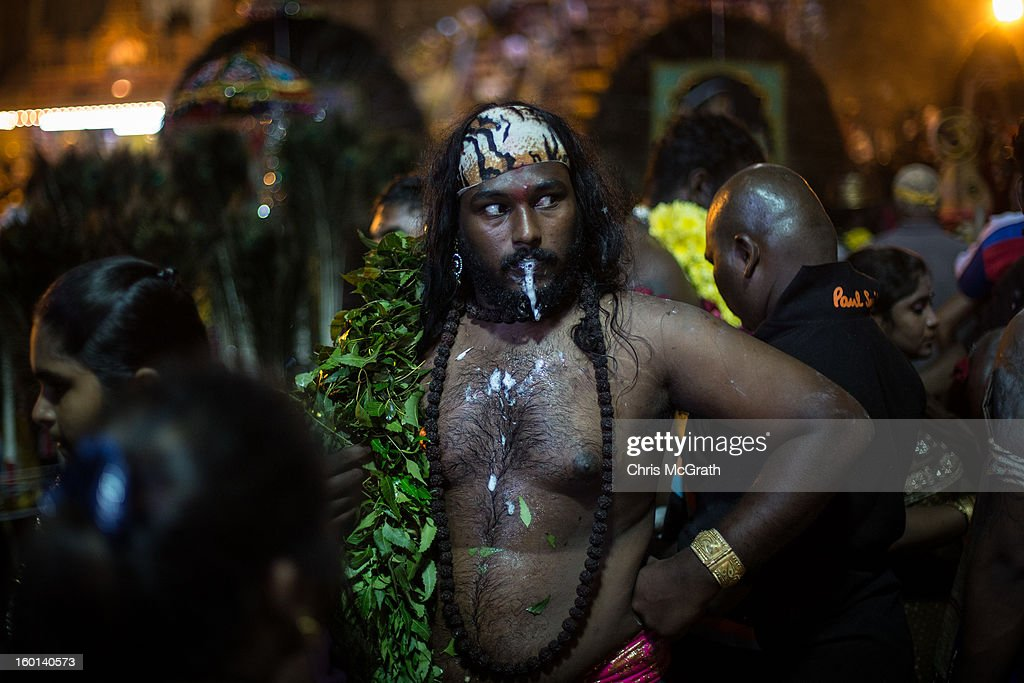 A devotee froths at the mouth while in a trance-like state after completing his Thaipusam procession on January 27, 2013 in Batu Caves, Malaysia. Thaipusam is a Hindu festival celebrated on the full moon in the Tamil month of Thai. The festival marks the birthday of Lord Muruga and also commemorates the day Hindu Goddess Parvati gave her son a lance to defeat the evil demon Soorapadamwhen. The festival sees devotees carry milk pots to seek forgivness and some will carry a 'Kavadi' many of which are attached via, strings, hooks, and skews pierced into the carriers skin.