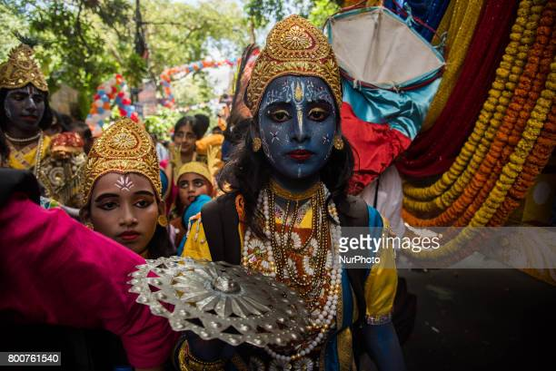 A devotee has dressed up like lord krishna to take part in the procession of Iskon rathyatra in Kolkata India on 2562017Rath Yatra or the cart...