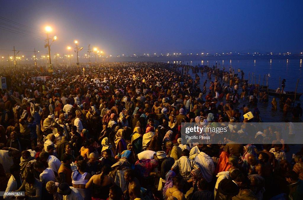 Devotee holydip at Sangam, the confluence of River Ganga Yamuna and mythological Saraswati on the occasion of Maghi Purnima the main holy bathing day during Magh mela festival.